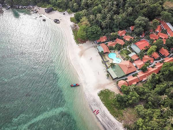 aerial-photography-of-house-near-sea